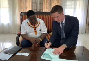 Norwell EDGE Tanzania MOU 1 Prof. Rutinwa Acting Vice Chancellor of the University of Dar es Salaam and Mike Adams Co founder of Norwell EDGE